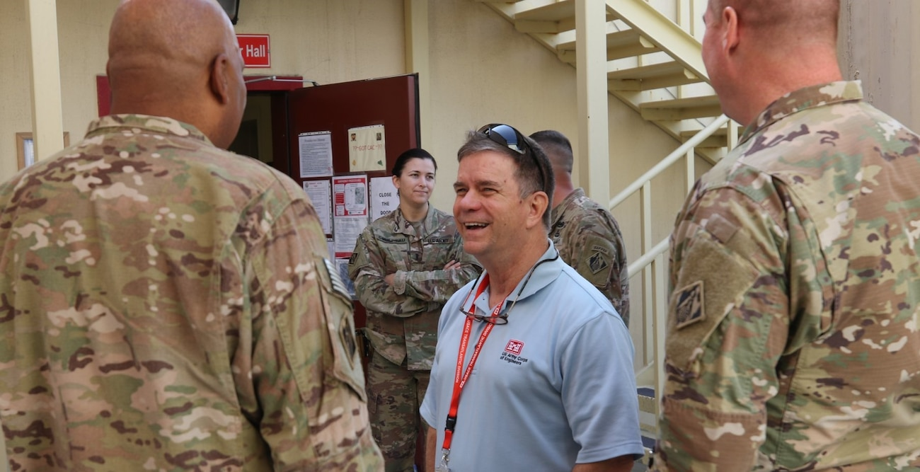 """Alvin """"Al"""" Lee, the Transatlantic Division's Director of Programs and Business, shares a light-hearted discussion with members of the Transatlantic Afghanistan District at Bagram Airfield, Afghanistan, in October 2019. Lee, who is a member of the Federal Government's Senior Executive Service, is one of only 30 individuals named this year as a Presidential Rank Award """"Distinguished Executives"""" – one of only four Department of the Army members receiving the recognition. The Presidential Rank Award is the top award a civilian Federal employee can receive. It is given to recognize exemplary Federal leaders who have overseen successful Federal initiatives with a sweeping impact."""