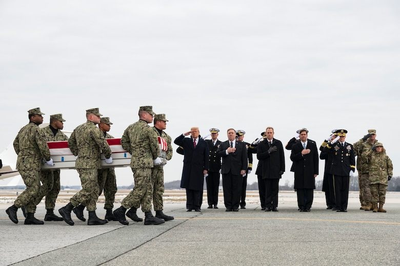 A U.S. Navy carry team transfers the remains of Scott A. Wirtz of St. Louis, Mo., during a dignified transfer Jan. 19, 2019, at Dover Air Force Base, Del. Wirtz was assigned to the Defense Intelligence Agency as an operations support specialist. (U.S. Air Force photo by Roland Balik)