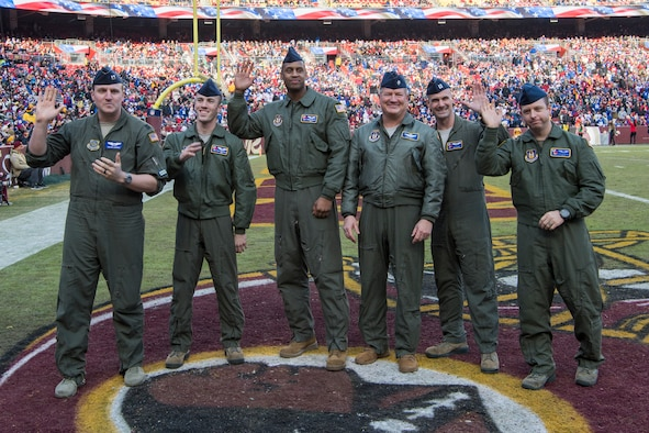 U.S. Airmen with the 732nd Airlift Squadron, 514th Air Mobility Wing and the 6th Airlift Squadron, 305th Air Mobility Wing are recognized for their military service and a fly-over they performed prior to a football game at FedEx Field, Landover, Md., Dec. 22, 2019.