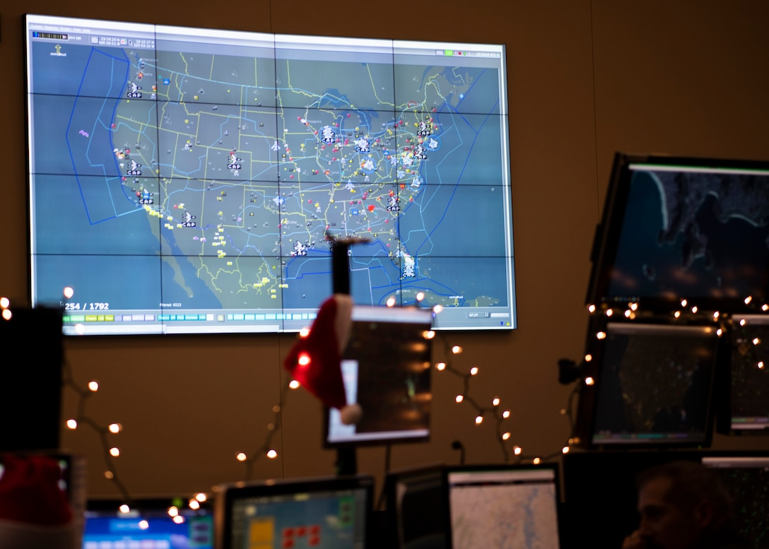 North American Aerospace Defense Command's operations center tracks flight patterns at Tyndall Air Force Base, Florida, Dec. 23, 2019. As part of NORAD Tracks Santa, satellite technology provides real time updates on Santa's location around the world. (U.S. Air Force photo by Senior Airman Cheyenne Larkin)