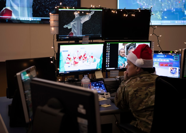 Master Sgt. Toni Clements, 601st Air Operations Center Combat Operations Division assistant superintendent, reviews a website during holiday operations, Tyndall Air Force Base, Florida, Dec. 23, 2019. For over 60 years, the North American Aerospace Defense Command has tracked Santa's progress around the globe. (U.S. Air Force photo by Senior Airman Cheyenne Larkin)