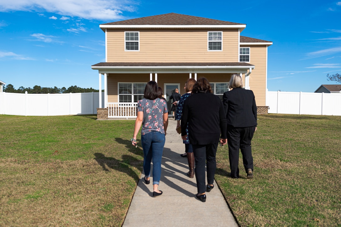 A photo of the housing manager giving a tour of base housing