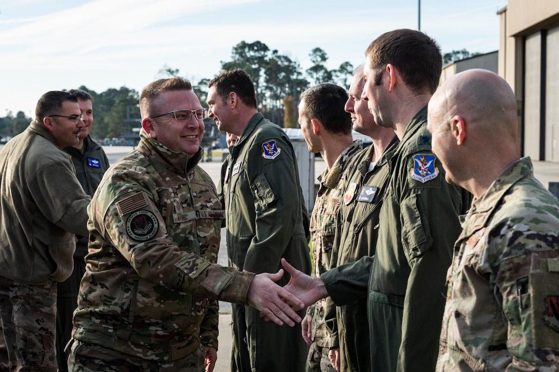 A photo of Airmen shaking hands