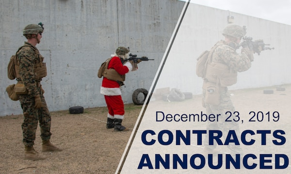 Marines conduct range operations with a man dressed in Santa suit.