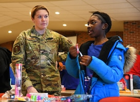 U.S. Air Force Airman First Class Grace Tinkey, 97th Training Squadron student, talks with Synthia Freeman at the Tipton Children's Home, Tipton. Okla.