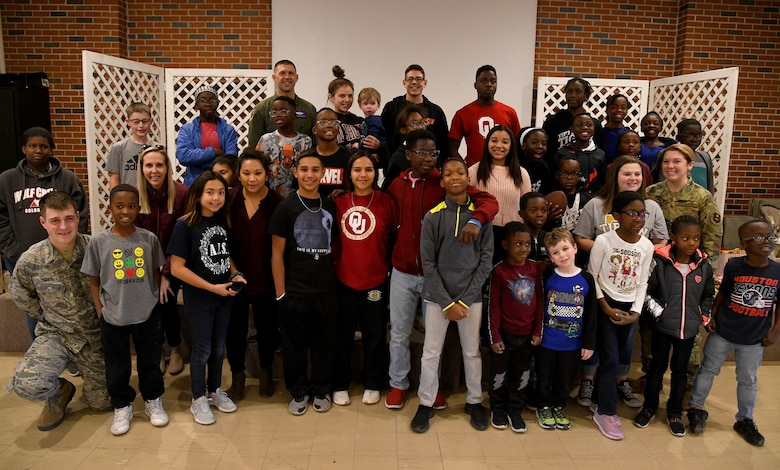 97th Operations Group (OG) members from Altus AFB, Altus. Okla. and residents of the Tipton Children Children's Home in Tipton, Okla.