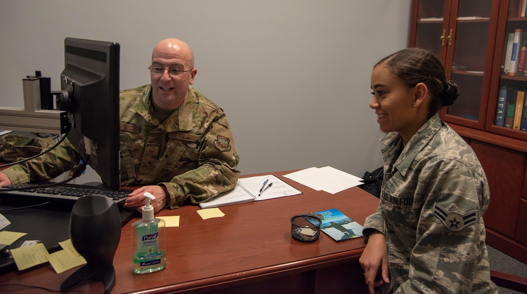 U.S. Air Force Master Sgt. Benjamin Barrett, 92nd Force Support Squadron career assistance advisor, gives Airman 1st Class Kiaundra Miller, 92nd Air Refueling Wing Public Affairs photojournalist, career advice at Fairchild Air Force Base, Washington, Dec. 18, 2019. Team Fairchild's career assistance advisor provides resources and a better look at options when Airmen arrive at a crossroads in their career. (U.S. Air Force photo by Airman Anneliese Kaiser)