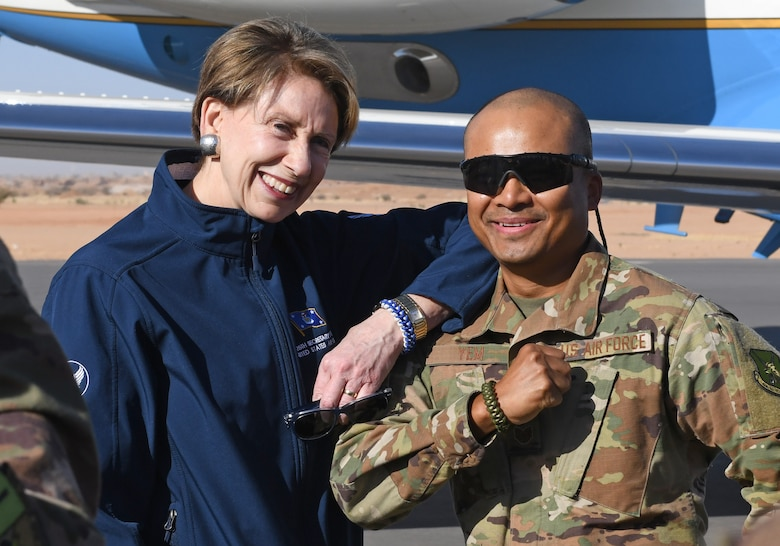 Secretary of the Air Force Barbara M. Barrett and U.S. Air Force Tech. Sgt. Siden Yem, 724th Expeditionary Air Base Squadron material management section chief, show off their paracord bracelets he made at Nigerien Air Base 201, Niger, Dec. 21, 2019. During her first visit to the African continent since taking office in October, Barrett's focus was centered solely on the U.S. service members deployed there. (U.S. Air Force photo by Staff Sgt. Alex Fox Echols III)