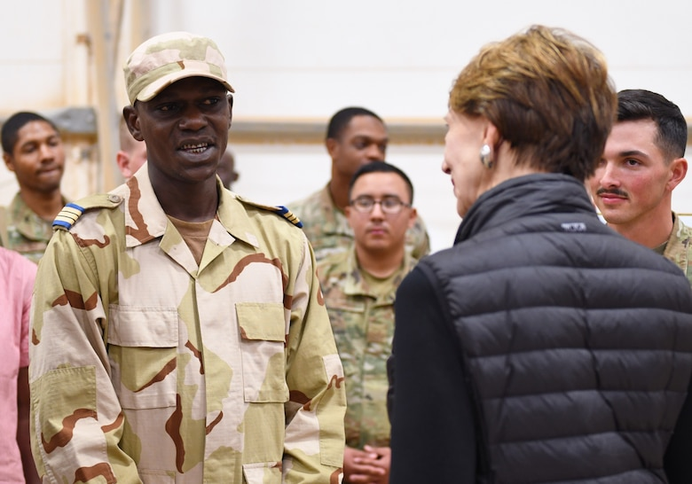 A member of the Forces Armées Nigeriennes (Nigerien Armed Forces) talks with Secretary of the Air Force Barbara M. Barrett during her visit to Nigerien Air Base 201, Niger, Dec. 21, 2019. Members of the 409th Expeditionary Security Forces Squadron and FAN work together through their cooperative partnership to vigilantly secure and defend the base. (U.S. Air Force photo by Staff Sgt. Alex Fox Echols III)