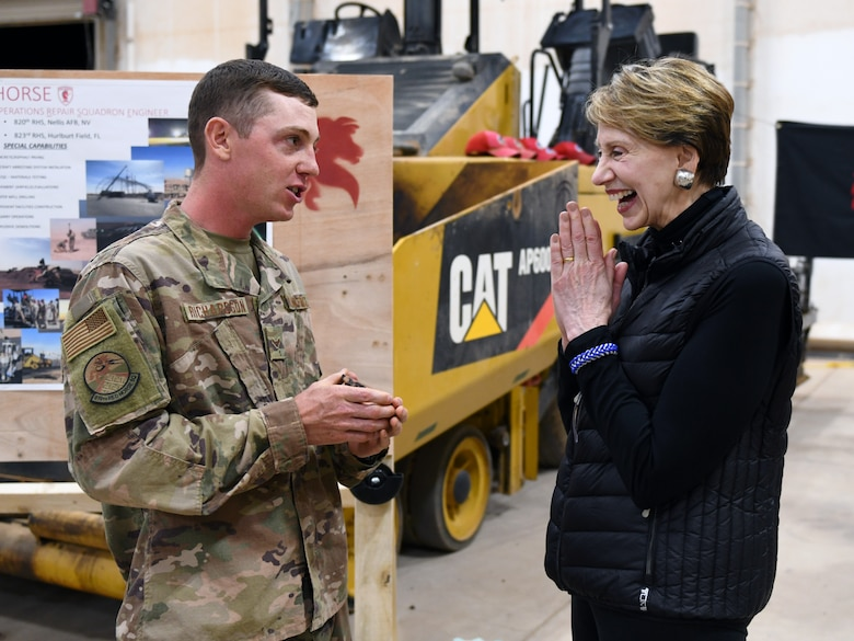 Secretary of the Air Force Barbara M. Barrett receives a coin made from a core sample of the flightline from an 819th Expeditionary Rapid Engineer Deployable Heavy Operational Repair Squadron Engineer Airmen during her visit to Nigerien Air Base 201, Niger, Dec. 21, 2019. During her first visit to the African continent since taking office in October, Barrett's focus was centered solely on the U.S. service members deployed there. (U.S. Air Force photo by Staff Sgt. Alex Fox Echols III)
