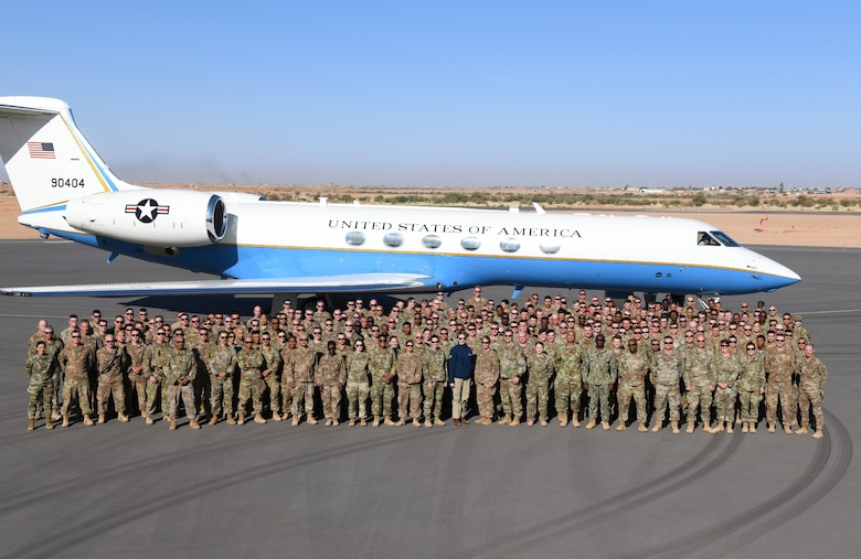 Secretary of the Air Force Barbara M. Barrett and service members deployed to Nigerien Air Base 201 pose for a photo in Agadez, Niger, Dec. 21, 2019. While at the installation, Barrett learned how each unit supports the mission from building the future of the base to defending its assets and personnel. (U.S. Air Force photo by Staff Sgt. Alex Fox Echols III)