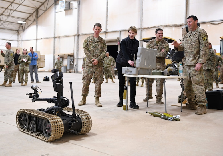 Secretary of the Air Force Barbara M. Barrett drives a bomb disposal robot used by the Explosive Ordnance Disposal Team deployed to the 724th Expeditionary Air Base Squadron during her visit to Nigerien Air Base 201, Niger, Dec. 21, 2019. While at the installation, Barrett learned how each unit supports the mission from building the future of the base to defending its assets and personnel. (U.S. Air Force photo by Staff Sgt. Alex Fox Echols III)