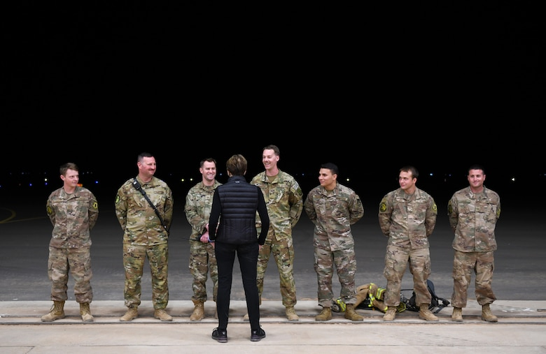 Secretary of the Air Force Barbara M. Barrett speaks to firefighters deployed to the 724th Expeditionary Air Base Squadron during her visit to Nigerien Air Base 201, Niger, Dec. 21, 2019. While at the installation, Barrett learned how each unit supports the mission from building the future of the base to defending its assets and personnel. (U.S. Air Force photo by Staff Sgt. Alex Fox Echols III)