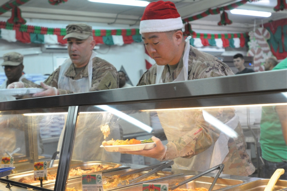 77th Sustainment Brigade continue the tradition of serving a holiday meal