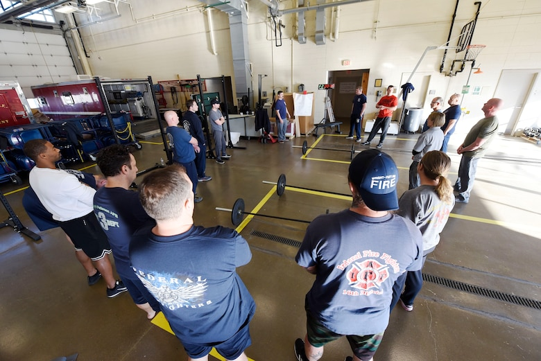 U.S. Air Force firefighters train to become peer fitness trainers at the 788th Civil Engineer Squadron Fire Station 1 at Wright-Patterson Air Force Base, Ohio on Thursday, December 19, 2019. Firefighters from the 72nd Air Base Wing Civil Engineer Squadron, Tinker AFB, Oklahoma and 66th Civil Engineer Squadron Hanscom AFB, Massachusetts, joined in the training which is aiming to double the number of certified peer trainers at fire stations. (U.S. Air Force Photo by Ty Greenlees)