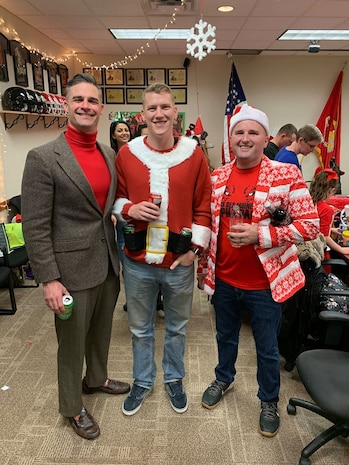 Maj. Patrick Skehan, Staff Sgt. McCoy Herold and Staff Sgt. Andrew Miller pose for a picture at the Recruiting Station Des Moines Iowa/Nebraska Christmas Part Dec 14, 2019. The recruiting staff from Iowa and Nebraska took some time to enjoy family, friends and fun during the holiday season.