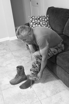 "Monica Echevarria, a student at Cole High School located at Joint Base San Antonio-Fort Sam Houston, took this image of a service member putting on their boots. The photo, titled ""Daily Military Life,"" is one of 101 images submitted by students in the Cole photography program that are included in an exhibit at the Fort Sam Houston Museum that opened Dec. 10."