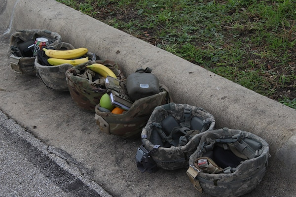 "Maricah Frank, a student at Cole High School located at Joint Base San Antonio-Fort Sam Houston, took this photo of upside down troop helmets filled with personal items and equipment in the parking lot in front of the old Brooke Army Medical Center at JBSA-Fort Sam Houston. The photo, titled ""Field Day,"" is one of 101 images submitted by students in the Cole photography program that are included in an exhibit at the Fort Sam Houston Museum that opened Dec. 10."