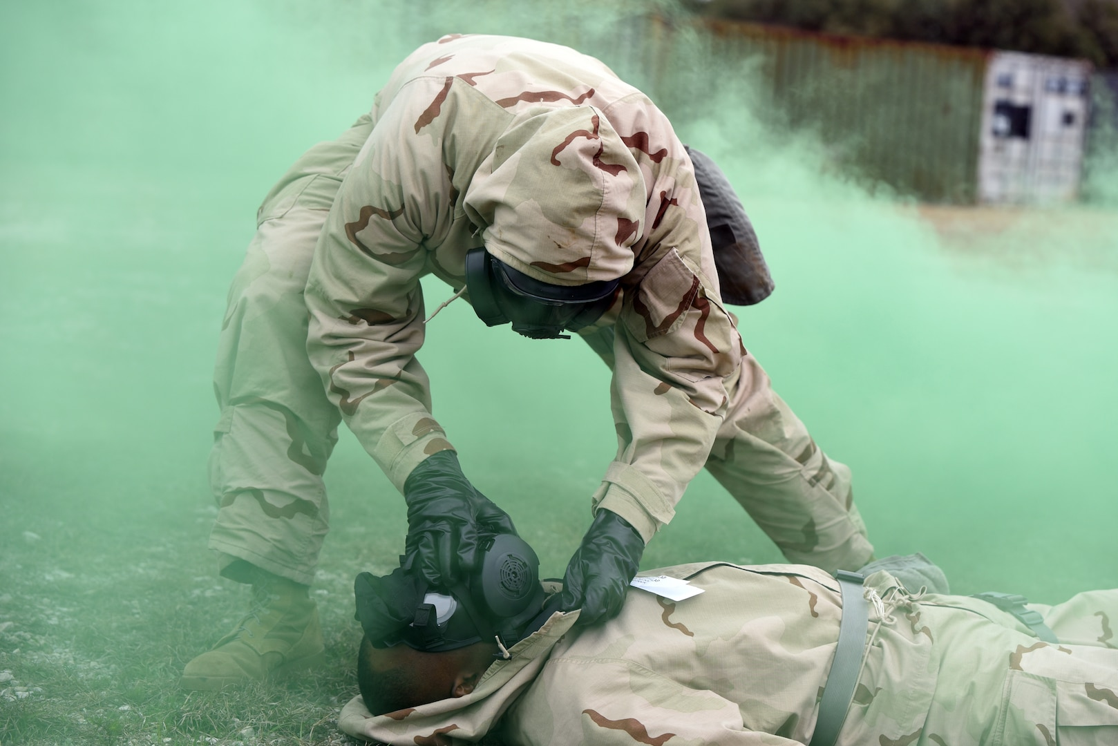 While training during a simulated Chemical, Biological, Radiological, and Nuclear, or CBRN, attack at Joint Base San Antonio-Camp Bullis, a Soldier checks a causality's Mission Oriented Protective Posture, or MOPP, mask.
