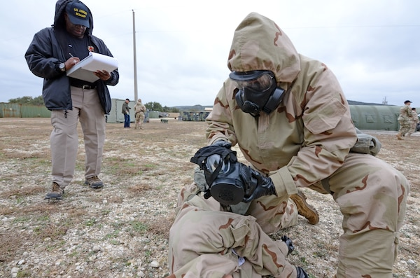 U.S. Army Medical Department Board test evaluator Eddie Fields writes down his observations during a similar auto-injector test performed earlier in 2019 at Joint Base San Antonio-Camp Bullis.