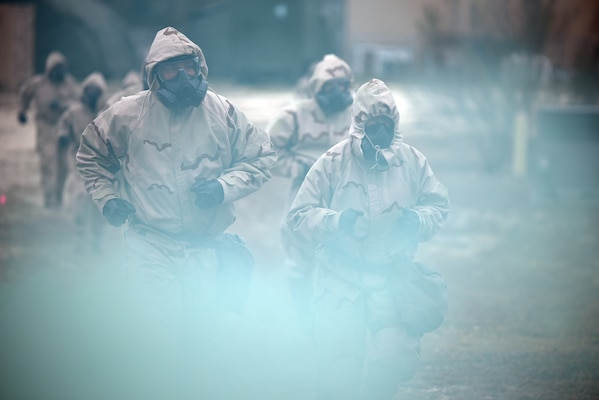 Soldiers wearing Mission Oriented Protective Posture, or MOPP, protective gear react to a simulated Chemical, Biological, Radiological, and Nuclear, or CBRN, attack at Joint Base San Antonio-Camp Bullis