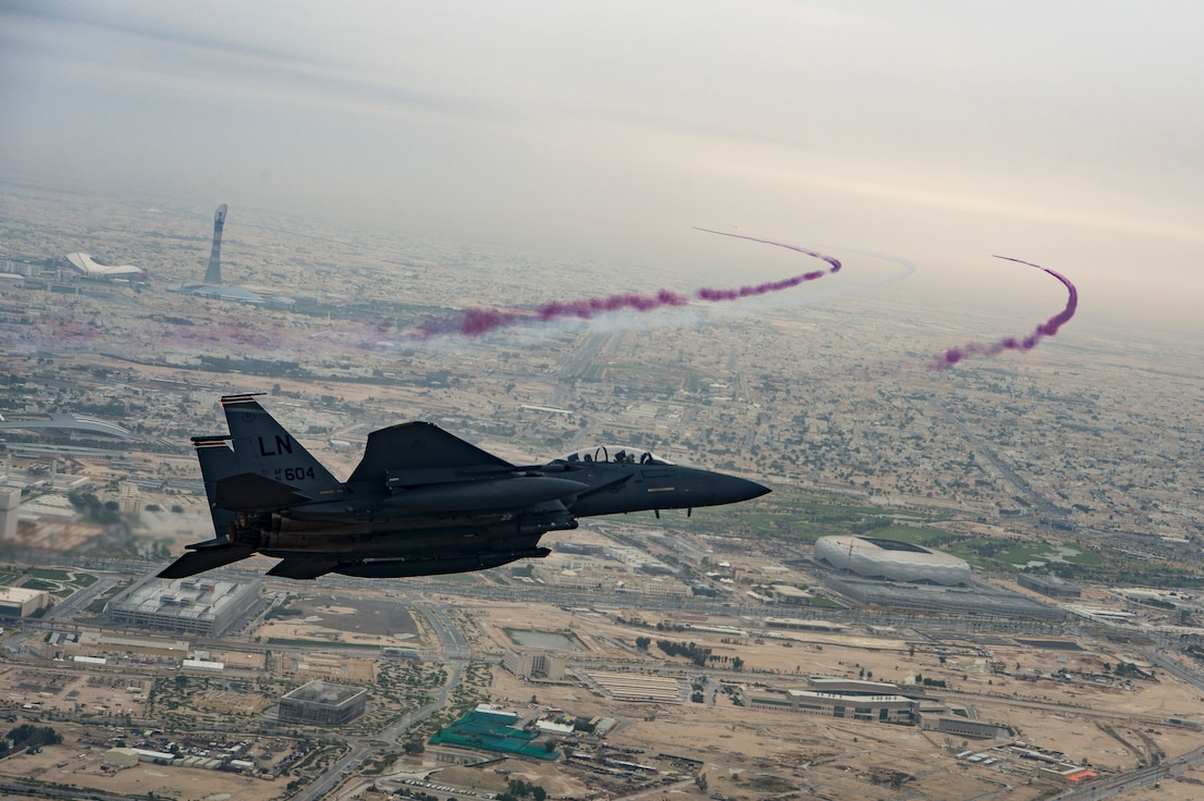 A U.S. Air Force F-15E Strike Eagle assigned to the 494th Expeditionary Fighter Squadron, conducts a formation fly over honoring Qatar National Day, Doha, Qatar Dec. 18, 2019.