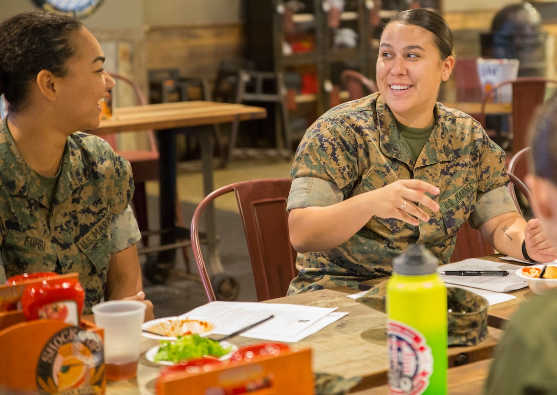 U.S. Marine Corps Sgt. Bianca Huish, right, president of the Single Marine Program Council, sits in session with fellow council representatives during a council meeting at the Roadhouse, Marine Corps Air Station Cherry Point, North Carolina, Oct. 24.