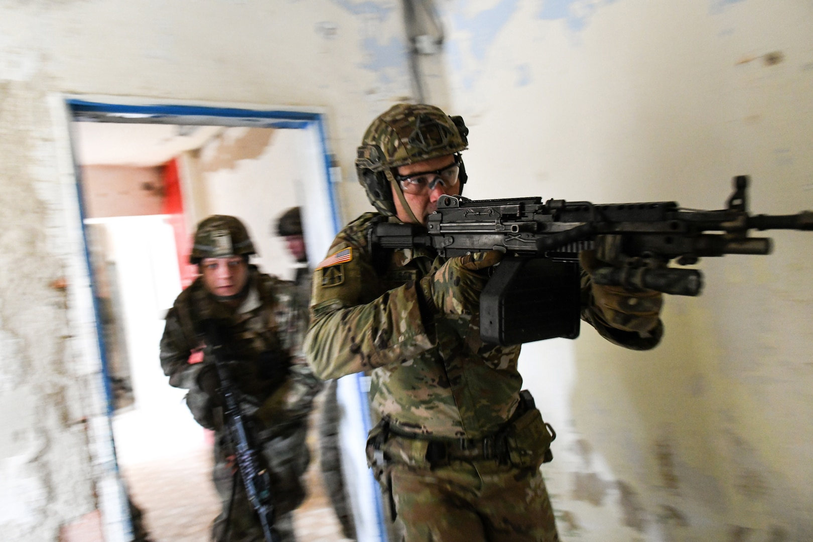 Spc. Jerrad Nicholson, with the Indiana Army National Guard's 1st Squadron, 152nd Cavalry Regiment, leads Soldiers into a room during Slovak Shield 2019, a training exercise in Lešt, Slovakia, Nov. 10, 2019, as part of the Defense Department's State Partnership Program.