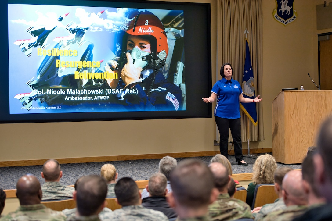 Retired Col. Nicole Malachowski, former commander of the 333d Fighter Squadron and ambassador for the Wounded Warrior Project, talks to Airmen during a visit at Schriever Air Force Base, Colorado, Dec. 19, 2019. Malachowski's military career came to a sudden halt after a tick bite resulted in life-altering neurological problems and for which she was medically retired. (U.S. Air Force photo by Katie Calvert)