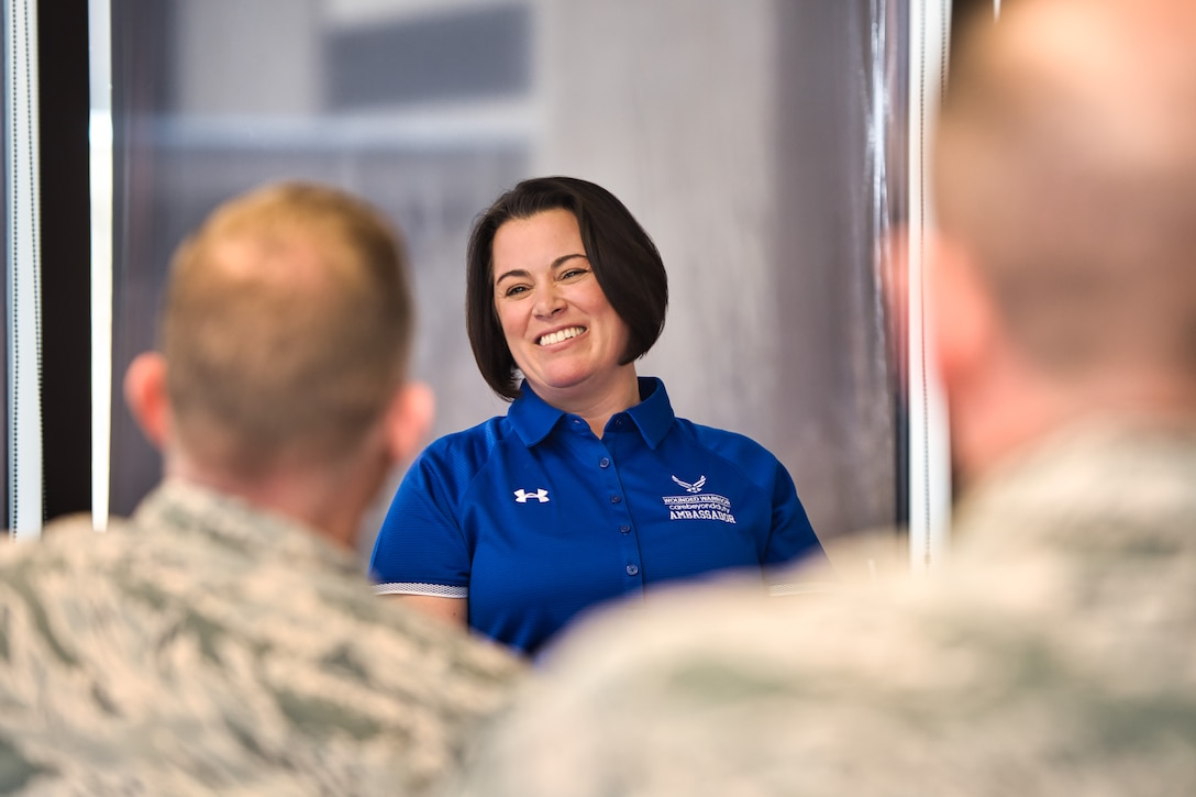 Retired Col. Nicole Malachowski laughs while sharing stories and lunch with Airmen during her visit to Schriever Air Force Base, Colorado, Dec. 19, 2019. Malachowski, who has endured multiple life challenges including suffering from a tick borne illness that ended her career as a fighter pilot, brought a message of hope and resurgence during a speaking engagement later that day. (U.S. Air Force photo by Katie Calvert)
