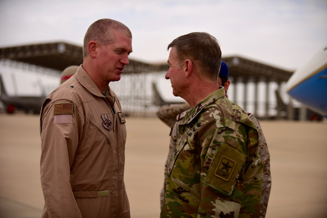 U.S. Army Chief of Staff, Gen. James McConville, greets U.S. Air Force Brig. Gen. John Walker, 378th Air Expeditionary Wing commander, during his visit to Prince Sultan Air Base, Kingdom of Saudi Arabia, Dec. 18, 2019.