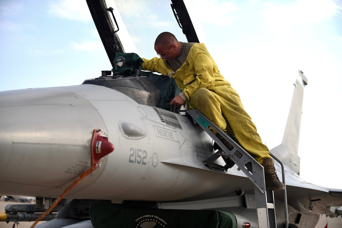U.S. Air Force Senior Airman Donavan Finn, 555th Expeditionary Aircraft Maintenance Unit crew chief, , inspects an F-16 Fighting Falcon, assigned to the 555th Expeditionary Fighter Squadron, Dec. 2, 2019 following its forward deployment to Prince Sultan Air Base, Saudi Arabia.