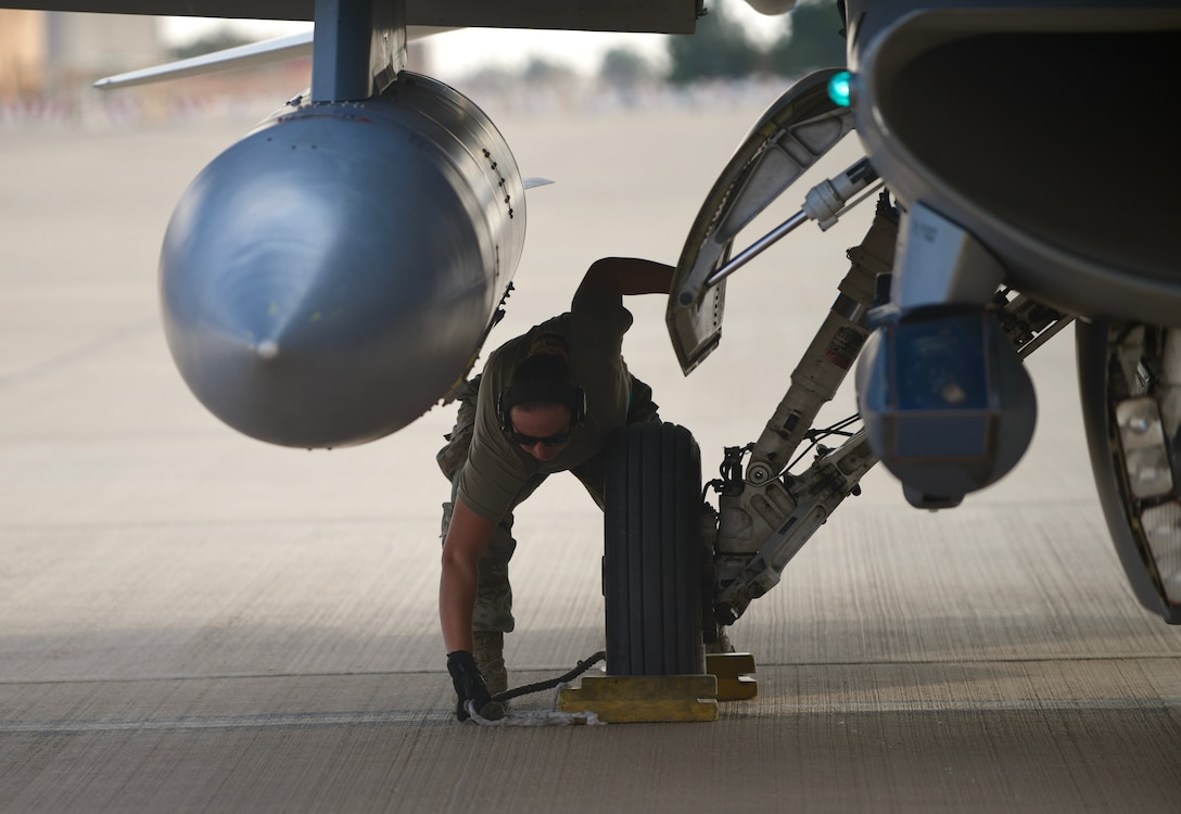 U.S. Air Force Senior Airman Eleanor Lapi, 555th Expeditionary Aircraft Maintenance Unit crew chief, inspects an F-16 Fighting Falcon, assigned to the 555th Expeditionary Fighter Squadron, Dec. 2, 2019 at Prince Sultan Air Base, Saudi Arabia.