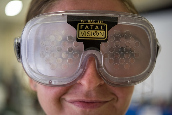 A U.S. Air Force 1st Fighter Wing Airman wears goggles that simulate the effects of being under the influence of alcohol during the Ready Airmen Program 2.0 event at Joint Base Langley-Eustis, Dec. 13, 2019. A standard drink is defined as 12 ounces of beer, 5 ounces of wine, or 1.5 ounces of distilled spirits, which contain the same amount of alcohol. (U.S. Air Force photo by Anthony Nin Leclerec)