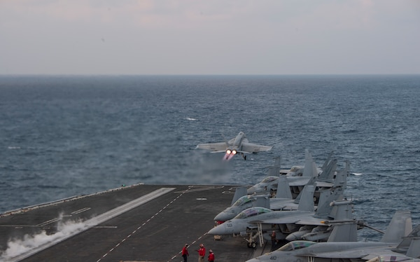 "An F/A-18E Super Hornet, attached to the ""Sunliners"" of Strike Fighter Squadron (VFA) 81, takes off from the flight deck of the aircraft carrier USS Harry S. Truman (CVN 75) in the Arabian Sea, Dec. 20, 2019. The Harry S. Truman Carrier Strike Group is deployed to the U.S. 5th Fleet area of operations in support of naval operations to ensure maritime stability and security in the Central Region, connecting the Mediterranean and the Pacific through the western Indian Ocean and three strategic choke points. (U.S. Navy photo by Mass Communication Specialist 2nd Class Jake Carrillo)"