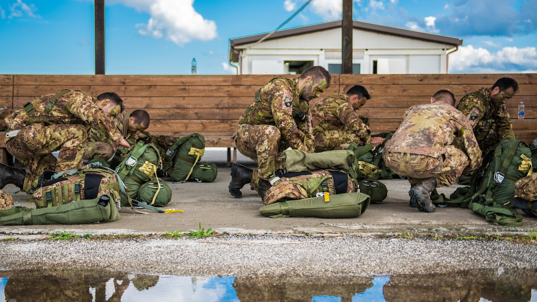 Members of the Italian Folgore, an airborne paratrooper brigade from the Italian Army, execute an airdrop mission alongside members of the Kentucky Air National Guard's 123rd Airlift Wing in Pisa, Italy, Nov. 7, 2019. The mission was part of Mangusta 19, a bi-lateral exercise designed to promote readiness and interoperability among NATO allies. (U.S. Air National Guard photo by Senior Airman Chloe Ochs)