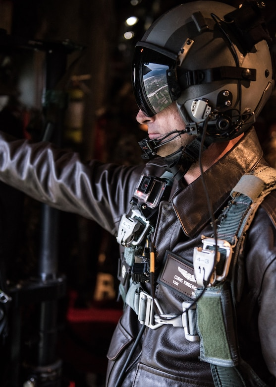 Tech. Sgt. Chris Kinberger, a loadmaster with Kentucky Air National Guard's 165th Airlift Squadron, prepares to execute an airdrop mission with members from the Italian Army Folgore paratrooper brigade Nov. 7, 2019, in Pisa, Italy. The mission was part of Mangusta 19, a bi-lateral exercise designed to promote readiness and interoperability among NATO allies. (U.S. Air National Guard photo by Senior Airman Chloe Ochs)