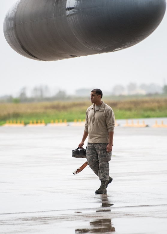 Senior Airman Josiah Hatcher, a crew chief from the Kentucky Air National Guard's 123rd Maintenance Group, prepares a C-130 Hercules aircraft for flight formation training in Pisa, Italy, Nov. 3, 2019. The sortie was part of Mangusta 19, a bi-lateral exercise with the Italian Army designed to promote readiness and interoperability among NATO allies. (U.S. Air National Guard photo by Senior Airman Chloe Ochs)