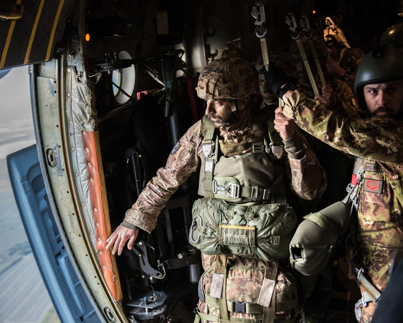 Members of the Italian Folgore, an paratrooper brigade from the Italian Army, execute an airdrop with members of the Kentucky Air National Guard's 123rd Airlift Wing in Pisa, Italy, Nov. 7, 2019, as part of Mangusta 19, a bilateral exercise to promote readiness and interoperability among NATO allies.