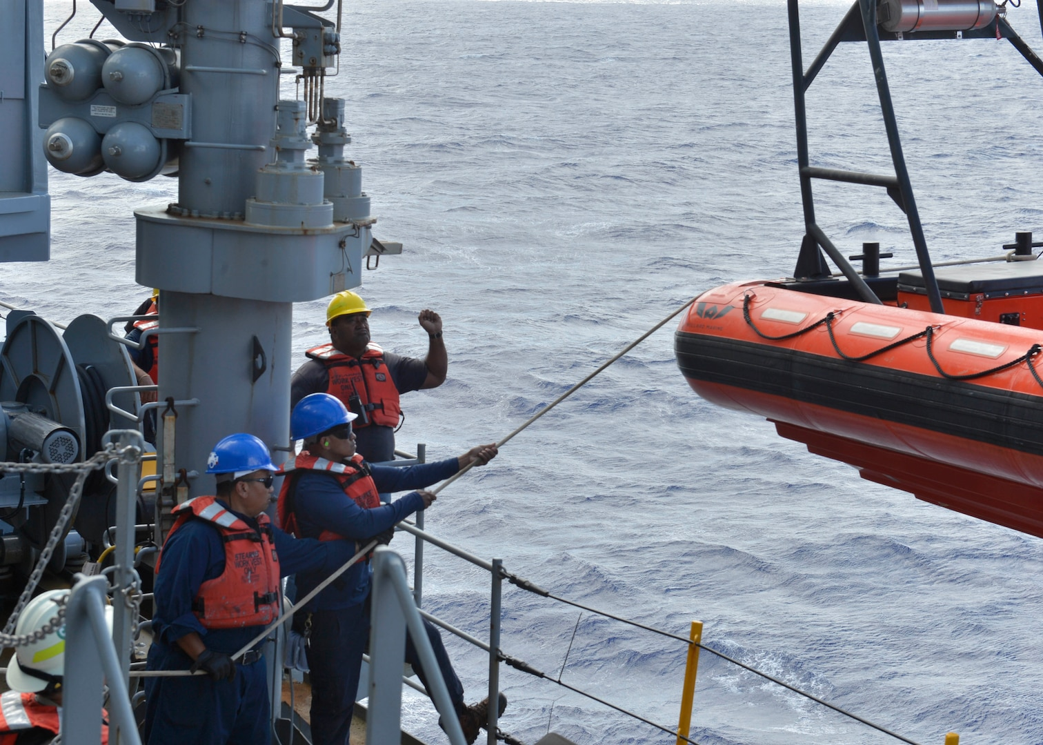 ilitary Sealift Command civilian mariners man the lines of a rigid-hull inflatable boat while participating in a man overboard drill aboard the submarine tender USS Frank Cable (AS 40) during sea trials, Dec. 17, 2019.