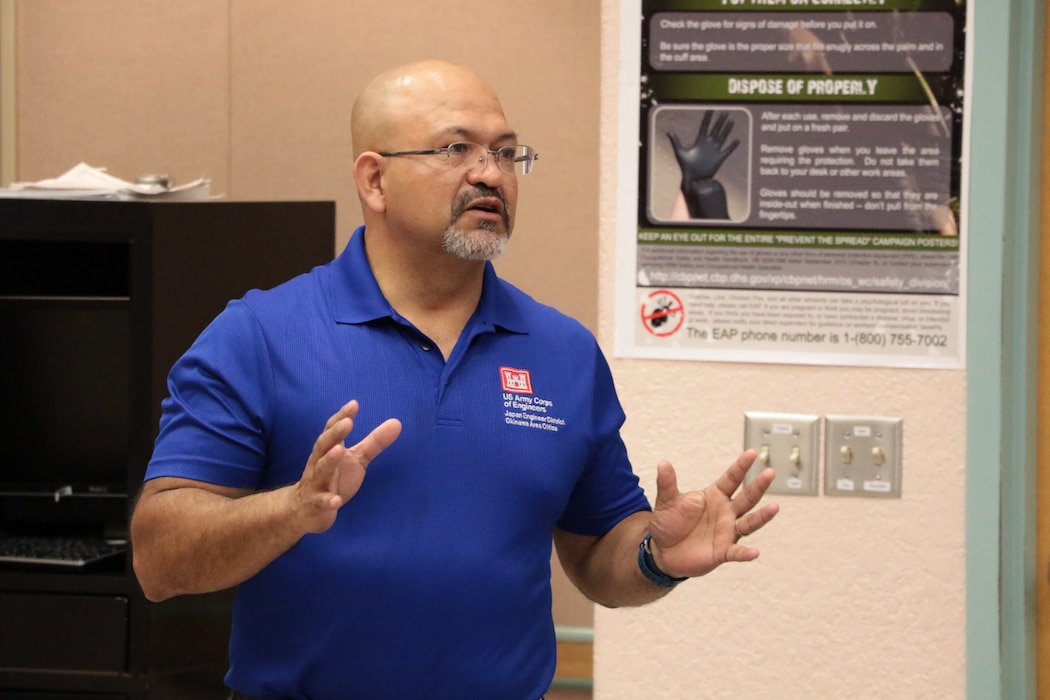 A U.S. Army Corps of Engineers employee briefs contractors near Columbus, New Mexico, April 11.