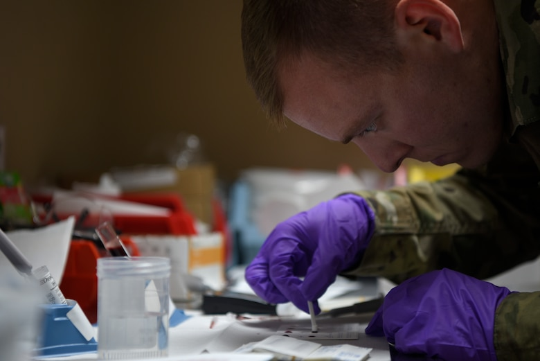 U.S. Air Force Staff Sgt. Duncan, 332d Expeditionary Medical Group medical technician, performs a blood typing test at the 332d Air Expeditionary Wing, Dec. 20, 2019. The 332 EMDG started the first walking blood bank for military members to provide blood in case of an emergency medical care incident. (U.S. Air Force photo by Tech. Sgt. Andrew Satran)