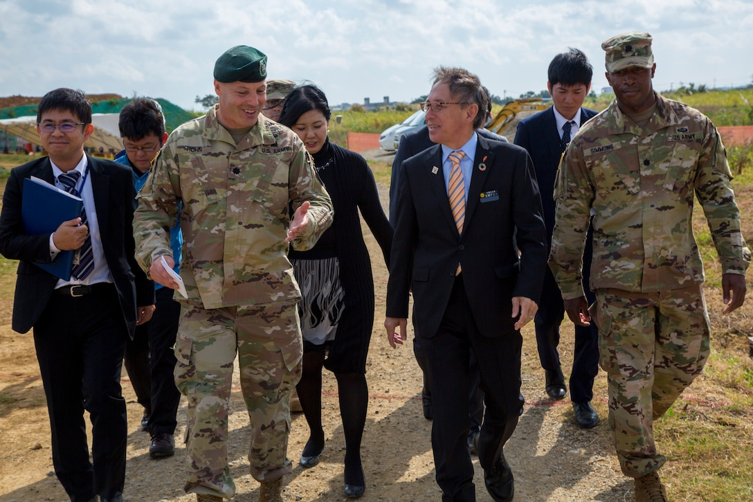 U. S. Army Garrison Okinawa Commander, Lt. Col. Zachary B. Hohn, discusses with Okinawa Governor, Denny Tamaki new construction plans on Torii Station, Okinawa, as part of the consolidation and relocation project Japan, Jan. 31, 2019. (U.S. Marine Corps photo by Lance Cpl. Nicole Rogge)