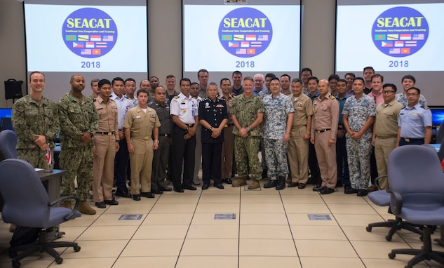 SEACAT 2018 exercise participants pose for a photo during the exercise's cosing ceremony.