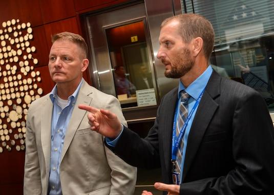 Rear Adm. Joey Tynch visits Brunei Embassy Charge d'Affaires Scott E. Woodward.