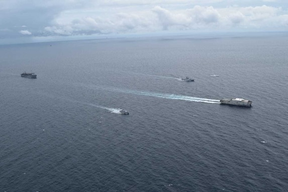 USNS Fall River steams in formation with Royal Brunei Navy ships.