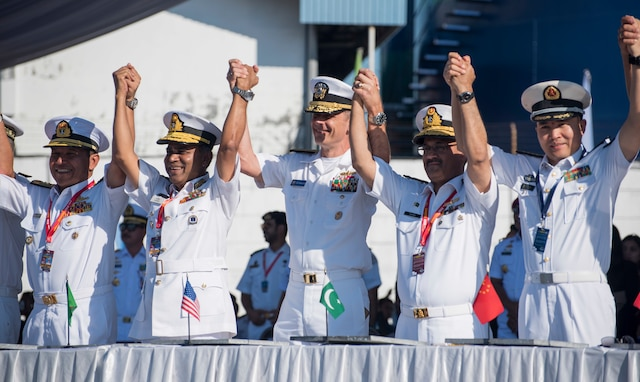 Rear Adm. Don Gabrielson celebrates with partner nation service members at the opening ceremony of Exercise Komodo.