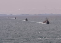USS Mustin steams in formation with Royal Thai Navy ships during a photo exercise as part of CARAT Thailand 2018.