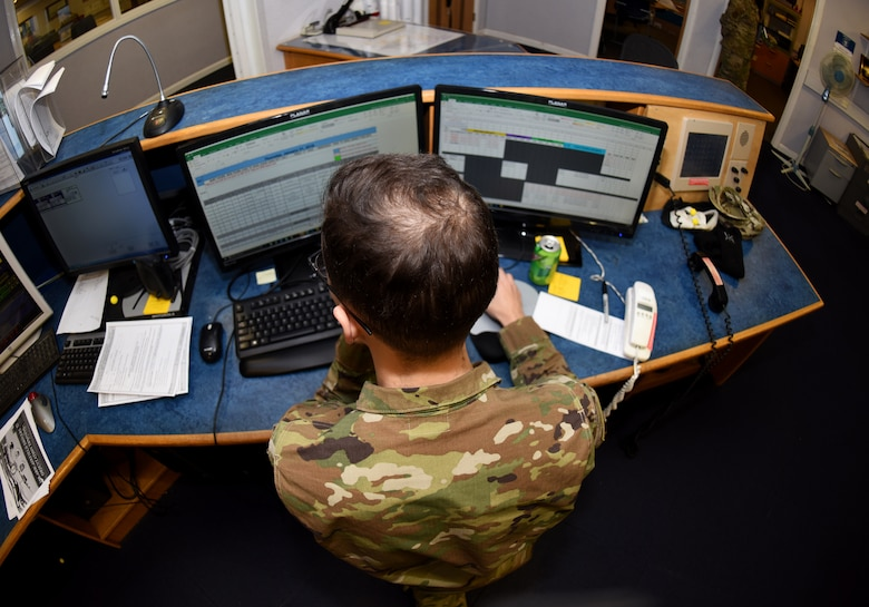 U.S. Air Force Senior Airman Deandre Timpson, 100th Operations Support Squadron Airfield Management shift lead, looks over aircraft flight plans at RAF Mildenhall, England, Jan. 31, 2019. Airfield management coordinate flight plans with Eurocontrol (The European Organisation for the Safety of Air Navigation), who provide free-flowing air traffic management across European airspace. (U.S. Air Force photo by Airman 1st Class Brandon Esau)