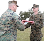 Sgt. James W. Wade II, right, administrative noncommissioned officer, Headquarters Company, Marine Corps Logistics Command, receives his Certificate of Reenlistment from Maj. Ryan C. Fielding, company commander, Headquarters Company, MARCORLOGCOM, during a ceremony aboard Marine Corps Logistics Base Albany, Ga., Jan. 30.